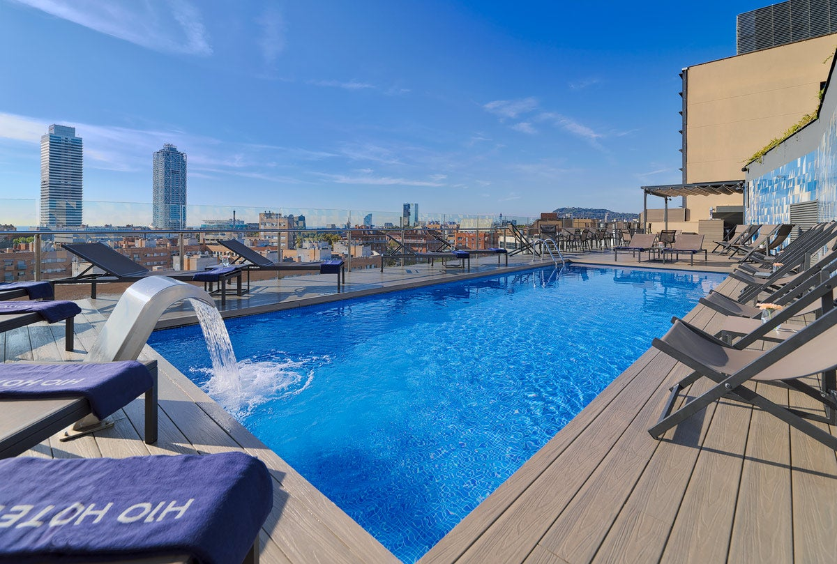 Charming Outdoor Pool With Views Of The City Skyline