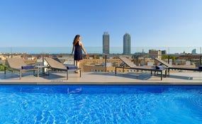 Outdoor pool with views of the city skyline