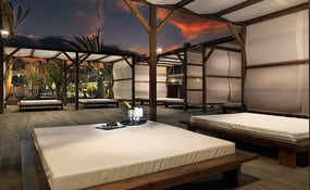 Night view of the balinese beds by the pool