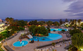 Night view of the hotel and pools