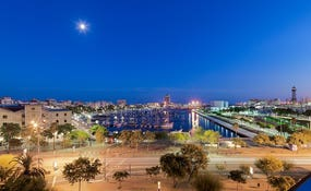 Panoramic night-time view of Port Vell from the hotel