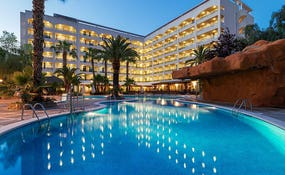 Hotel and swimming pool general night view