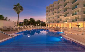 Hotel and swimming pools general night view