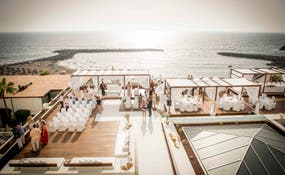 Aerial view of a wedding set-up facing the sea